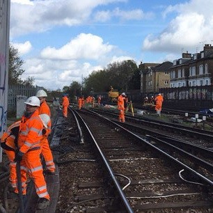 Railway construction workers paid to stand around doing nothing